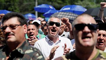 Сторонники Демократической партии Молдовы участвуют в митинге в Кишиневе, Молдова
