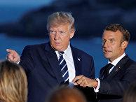 Президент Франции Эммануэль Макрон беседует с президентом США Дональдом Трампом
