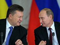 Президент России Владимир Путин (справа) и президент Украины Виктор Янукович