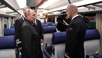 """Президент РФ В. Путин посетил депо на железнодорожной станции """"Москва-Киевская"""""""