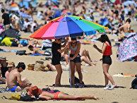Посетители пляжа в Мельбурне, Австралия