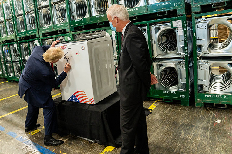 President Donald J. Trump signs a washing machine during his tour Thursday, August 6, 2020, at the Whirlpool Corporation Manufacturing Plant in Clyde, Ohio.