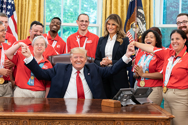 President Donald J. Trump and First Lady Melania Trump meet with members of Team USA for the 2019 Special Olympics World Games Thursday, July 18, 2019, in the Oval Office of the White House.