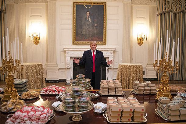 President Donald J. Trump welcomes members of the press to the State Dining Room Monday, January 14, 2019, where the 2018 NCAA Football National Champions, the Clemson Tigers, will be welcomed with food from Domino's, McDonald's, Wendy's and Burger King.