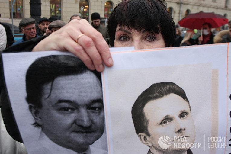 Участница митинга за реформу правоохранительных органов