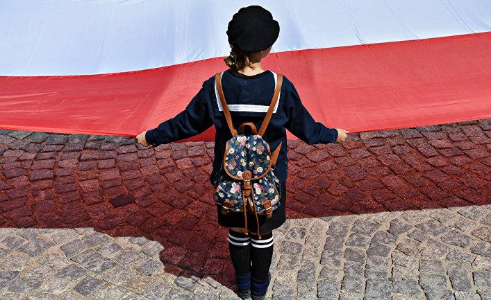 Участница марша памяти жертв Волынской резни в Пшемышле