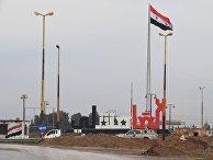 Стела у въезда в город Аль-Камышли