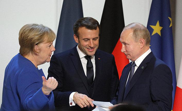 Канцлер Германии Ангела Меркель, президент Франции Эммануэль Макрон и президент России Владимир Путин