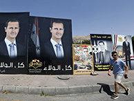 Плакаты с изображением президента Сирии Башара Асада в предверии президентских выборов в Дамаске