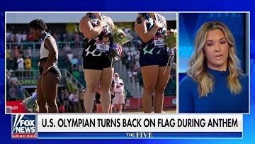 Гвен Берри повернулась спиной к американскому флагу